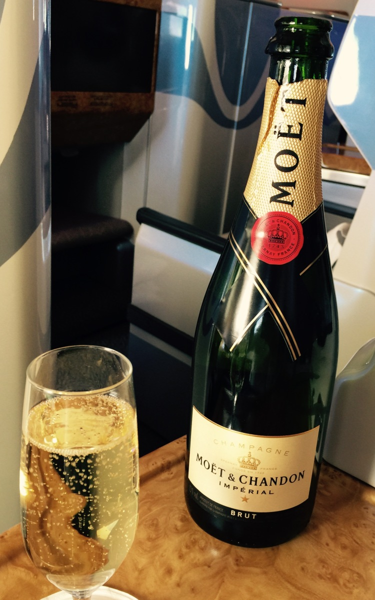 Emirates bus Class champagne